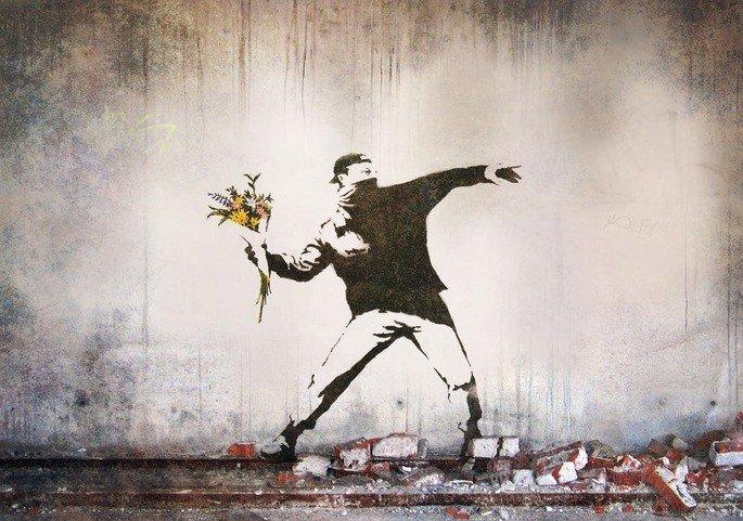Soldier throwing flowers banksy